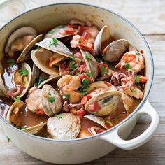 Italian Shellfish Stew Recipe with extra-virgin olive oil, yellow onion, garlic cloves, plum tomatoes, red pepper flakes, tomato sauce, dry red wine, squid, tentacles, whitefish fillets, sea scallops, shrimp, clams, well scrub, whole wheat bread, flat leaf parsley