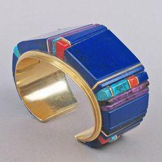 Cuff | Verma Nequatewa (Hopi Pueblo).  14K gold, lapis lazuli, coral, turquoise and sugilite