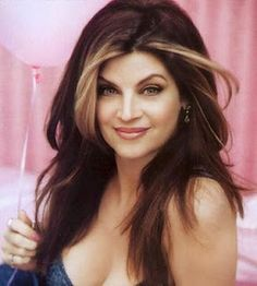 Dark hair with highlights in the front      Kirstie Alley