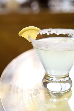 Lemon Drop Cocktail Recipe - rim glass with sugar; shake with ice: 2 oz Vodka, 1/2 oz Triple sec, 1 oz simple syrup, 1 oz fresh lemon juice; strain into glass; garnish with lemon.