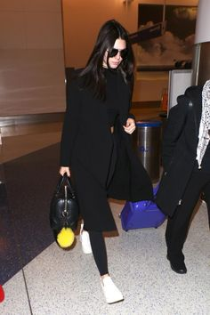 Kendall Jenner wearing Givenchy Lucrezia Bag, Celine Sneaker Pull on in Optic White Stretched Lambskin, Ty-Lr Classic Coat, Fendi Smile Fur Pom-Pom Charm and Louis Vuitton Pegase 55 Suitcase in Figure Epi Leather