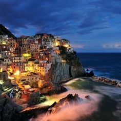 The cliff side city of Manarola, Italy is considered to be one of the most colorful towns in the world!
