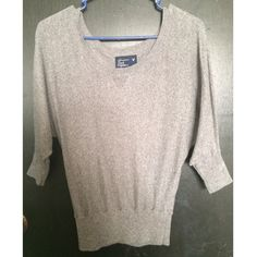 Quarter Sleeve Marled Sweater This marled grey sweater is so comfy and flattering on. Gently worn condition, no rips or stains. Prices are flexible, feel free to ask questions :) American Eagle Outfitters Sweaters Crew & Scoop Necks