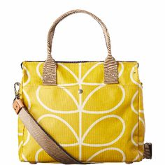 Orla Kiely Orla Kiely Giant Linear Stem Zip Messenger : Matte laminated Zip Messenger bag in Giant Linear Stem print with leather trims, double sided webbing handles and contrast coloured zip closure. Includes additional adjustable detachable long strap that allows the bag to be worn as a shoulder bag or across the body (max 112cm).