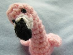 """Meet Roy, the friendly flamingo! He's made with worsted weight yarn and F (3.75mm) hook and measures 5"""" (with legs). If you want him to be even tinier, you can use DK, sport or even fingering yarn and he'll be so small you can use him as a key-ring and take him everywhere with you! Hope you'll enjoy the pattern!"""