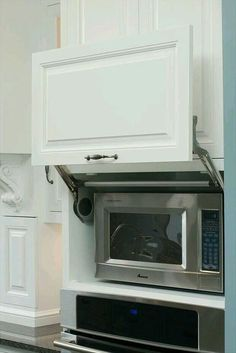 Mira estos 25 muebles de cocina para colocar tu microondas