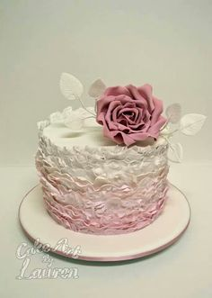 Beautiful ruffled  pink & white cake topped with a single pink  rose....Cake Art by Lauren