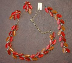 This is a stunning set of vintage thermoset orange, tan, brown leaves jewelry. Necklace, bracelet, and earrings are just amazing in person. It's a signed Lisner parure.