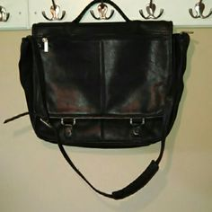 Wilsons Leather Black Expandable Messenger Bag Wilsons Leather black expandable messenger/laptop bag with crossbody strap. Front flap with buckles at the bottom & zip compartment. When lifted, the flap reveals another zip compartment. The large main compartment contains a large sleeve, cell phone pocket & 3 pen pockets. There is a zip compartment on the back as well. Slightly distressed but in very good condition! Just cleaned with leather cleaner. Front flap has 3 small spots & very minor…