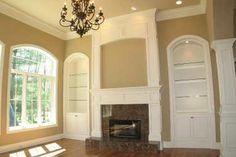 no vaulted ceilings floor to ceilng shelves no granite tile just moulding or stone and a bay window instead but beautiful.