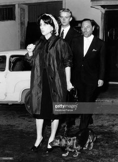 Italian actress Anna MAGNANI and writer and playwright Tennessee WILLIAMS, long-time friends, coming out of a discotheque on April 11, 1961 in Rome.