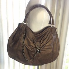 Olivia & Joy Hobo Beautiful brown distressed leather hobo bag by Olivia and Joy!  Top zip closure!  Three inside pockets one zip pocket. Silver lock, key and chain adorn the outside of the bag. Measurements Olivia + Joy Bags Hobos