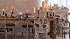 Dining table and different types of Swedish chairs.
