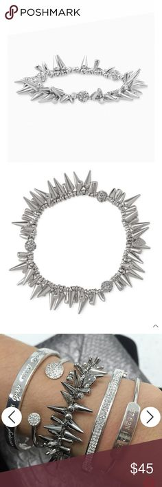 """Stella & Dot Silver Renegade Bracelet White bronze plated spikes and black diamond pave beads adorn this Renegade cluster studded bracelet. Mix, match, and stack it with other bracelets to create your favorite combination. Purchased new directly from Stella & Dot, have gently worn only once or twice. Has not been stretched other than to slip it over my wrist. Stunning paiefr with the Stella & Dot Renegade bracelet as shown in the photos, also available from my closet!   2 1/4"""" inner…"""
