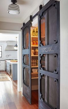 These add a charm to this and Kristina Crestin Design Pantry doors. Pantry antique door hung with barn door hardware. Antique doors look even better if installed as sliding Farmhouse Homes, Modern Farmhouse, Farmhouse Decor, Farmhouse Ideas, Modern Barn, Rustic Decor, Stil Farmhouse, Modern Rustic, Country Kitchen Ideas Farmhouse Style