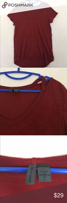 Anthropologie Cut Out Left of Center Tee Red Anthropologie Slub Cutout Cut out tee in a dark red. 100% cotton. Longer in the back than in the front. Brand is left of center. Great condition! Anthropologie Tops Tees - Short Sleeve