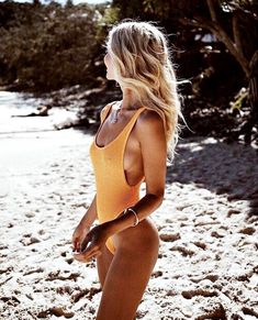 Summer style. Blonde hair. Summer hair. Yellow one piece bathing suit