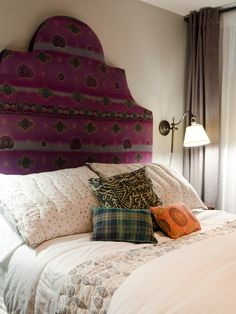 Bold and bright sari headboard with accent cushions