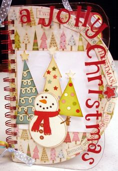 A Jolly Christmas Mixed Media Album made with Album-Mix and Match #1 by AccuCut. Love the clear plastic and the super cute snowman imagery.