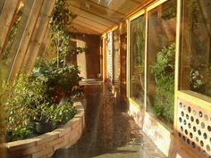 Inside the conservatory at the Brighton Earthship