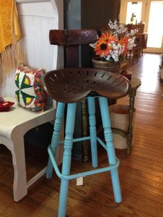 Tractor seat stool. Seat has original backrest and we kept the swivel mechanism, chalk painted turquoise, sanded, distressed and sealed with wax.