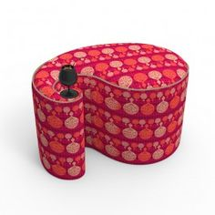 Kuheli Carved Circles Paisley Pouff : This paisley-shaped Kuheli Pouf has intricate floral designs in bulb-like motifs. A stunning black-coloured wine glass, placed at the narrow curve of the pouf, sets the mood of this lovely piece of furniture.