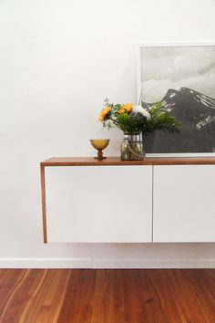 """Fauxdenza from The Brick House blog: Ikea Akurum kitchen cabinets with Applad doors + custom framing in Afrormosia (""""Faux Teak"""") = $300 beautiful floating console of my dreams"""