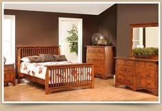 Handcrafted by the renowned Amish furniture artisans of Ohio, this Amish Bedroom Set is hardwood throughout, featuring stunning Mission slats in the Bed headboard and footboard.