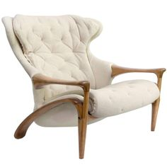Amazing Scandinavian Modern Sculpted Framed Wing Chair   From a unique collection of antique and modern lounge chairs at https://www.1stdibs.com/furniture/seating/lounge-chairs/