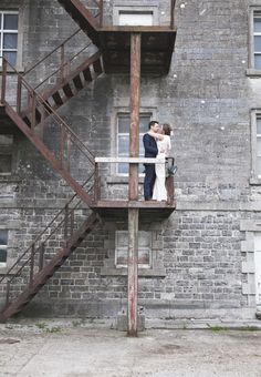 wedding couple standing on cool rusty stairs at the Millhouse Slane Wedding Photography Styles, Wedding Couples, Wedding Venues, Stairs, Illustration, Wedding Reception Venues, Stairways, Wedding Places, Ladder
