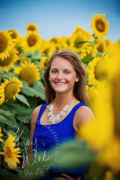 Check out this UNIQUE Senior Girl shot in the Sunflowers!  Call today- these beauties won't be around long!  Kay Web Photography | Saint Charles, MO | Posts Senior Girl Photography Senior Boy Photography  Unique Senior Pictures Sunflower Senior Pictures