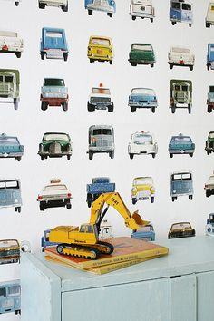 Cars wallpaper for little boy's room @Jenny LaPoint. Great for the closet doors