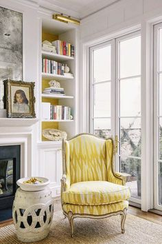 I love the mirror above the fireplace, the yellow fabric on the chair, and the garden stool.
