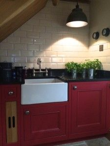 The kitchen is from a shaker style range called 1909, and I had it painted in Farrow & Ball Rectory Red and Ringwold Ground. The mantelpiece is oak as is ...