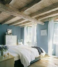 Muted blue and white bedroom. Like the flowy white curtains and gray blue wall color.