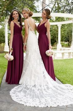 The contrast of the maroon with this gorgeous bridal gown is breathtaking.  It's perfect for a wedding any time of the year.  For more amazing wedding gowns and bridesmaids dresses, click the image.  Low's Bridal wedding boutique in Brinkley is the place to find your dream gown. Photo credit: Low's Bridal & Formal