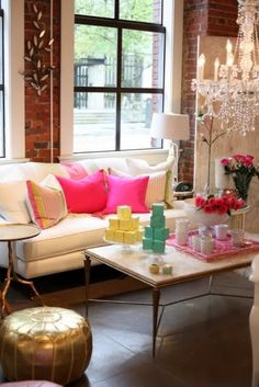 LOVE this living room! The colors are fantastic and the pops of pink clearly sing to my heart!!