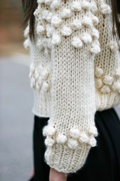 knit detail: pom pom sweater