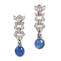 Art Deco Cabochon Sapphire Diamond Platinum Dangle Earrings. Art Deco original platinum earrings for pierced ears with a genuine natural blue untreated star sapphire at the bottom. From a very wealthy Westchester County New York Estate. This family was known for the finest of jewels for their family members in the 1920.