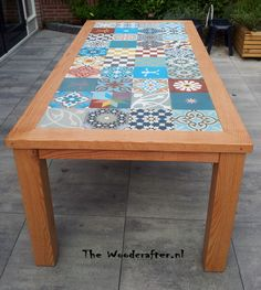 Red American oak, outdoor table, with a Portugese tiled tabletop. made by http://www.thewoodcrafter.nl