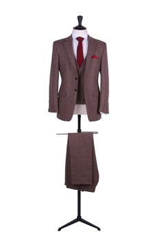 """Vintage English tweed slim fit lounge suit.  choose from matching low cut single breasted or classic double breasted..  A contemporary slim cut lounge in a classic style suit with slim 16"""" bottom trousers.  Men's sizes from 32"""" chest upwards and include extra short, short, regular, long and extra long fittings. Boys sizes from 20"""" chest to 34"""" chest.  Hire prices start from £265 for a 3 piece suit.  Complete men's hire outfitsare available for £..."""