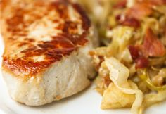 Pork chops with creamy cabbage and apples.