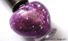 Awesome heart-shaped bottle with glittery purple nail polish