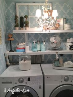 Small laundry room redo with vintage touches at 11 Magnolia Lane, featured in Cottages & Bungalows January 2013 issue. Love the idea of a chandelier in the laundry room