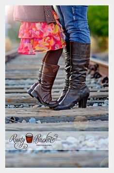 I think a pic like this with both girls standing on his shoes would be adorable