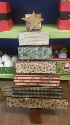 Wooden christmas tree / pallet christmas tree using scrapbook paper @yourefiredox made by Lisa Leishman