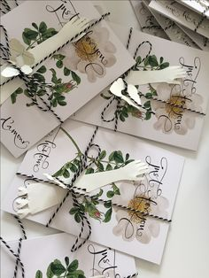 Bespoke cards with paper- cut hands and butterflies attached  for wedding event in Copenhagen.