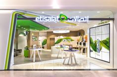 Featuring an inviting, wide-open façade that draws customers over the threshold, the new store design presents Etisalat's 'Life: Connected' as a series of engaging experiences within a warm, sociable environment. Retail Interior Design, Retail Store Design, Retail Shop, Visual Merchandising, Exibition Design, Interior Sliding Barn Doors, Exhibition Booth Design, Mobile Shop, Digital Signage