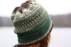 WAITING FOR SPRING is worked in the round from the crown down. It is made up of 5 panels of colorwork patterning. The top of the hat begins with a deep brown then changes from a light green to a deep green symboliz- ing the melting away of winter white to reveal the emerging green of spring. This is my first hat pattern. I hope you enjoy knitting this colorwork piece as much as I enjoyed designing it. My pattern is written a little differently from others that I have seen, I am hoping the…