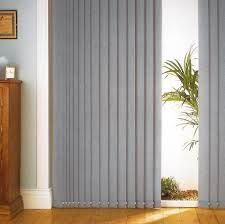 Vertical blinds on a slid-ding glass door, with a center open stack